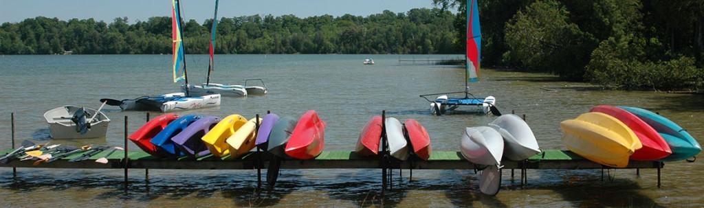 Boats and Kayaks anchored on the lake